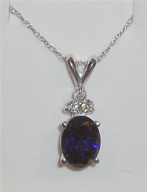 4006: Saphire Oval Estate Necklace with Three Cut Diamo