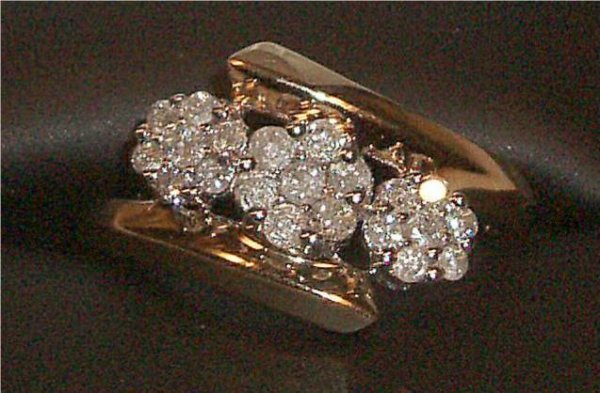 4010: Ladie's Diamond Cluster Floral Three Stone Ring