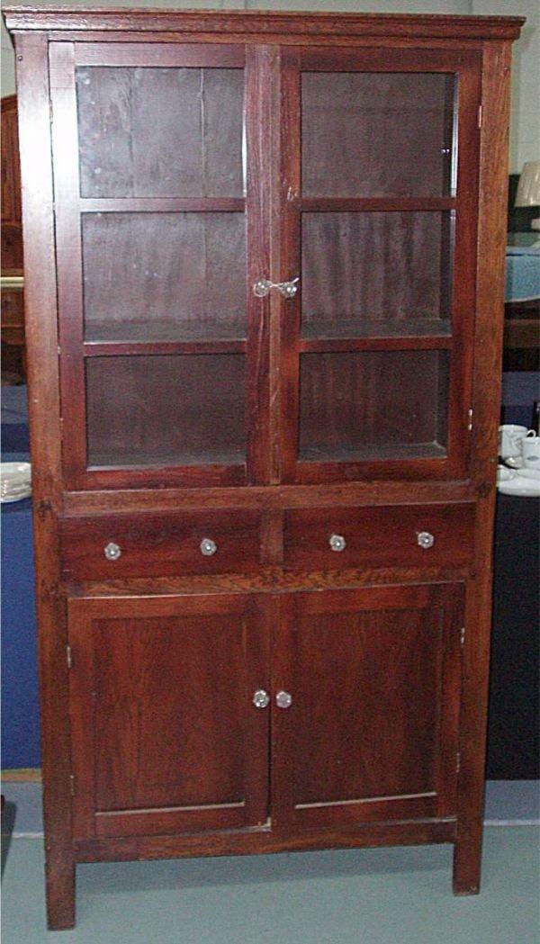 1010: Primitive Two Glass Door Flatwall Cupboard