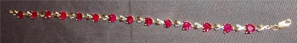 1015B: 10Kt YG Diamond/Ruby Tennis Bracelet from Helzbe