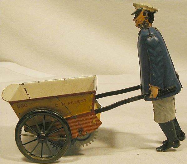 6019: Lehmann Tap Tap , man pushing wheelbarrow, 6 1/4