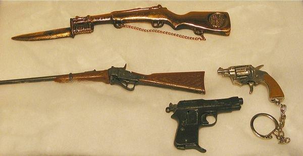1014: Four Miniature Gun Souvenirs, Key Chains, Etc.