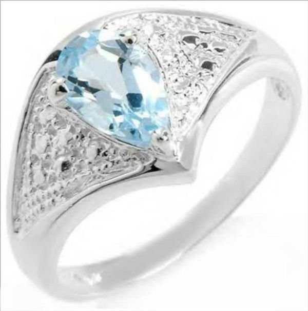 3007: Charming Ring With 1.00ctw Genuine Topaz Made in