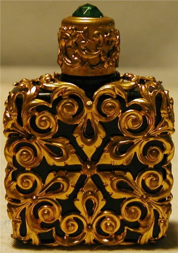 3002B: Black and Gold Encased Perfume Bottle with Emera