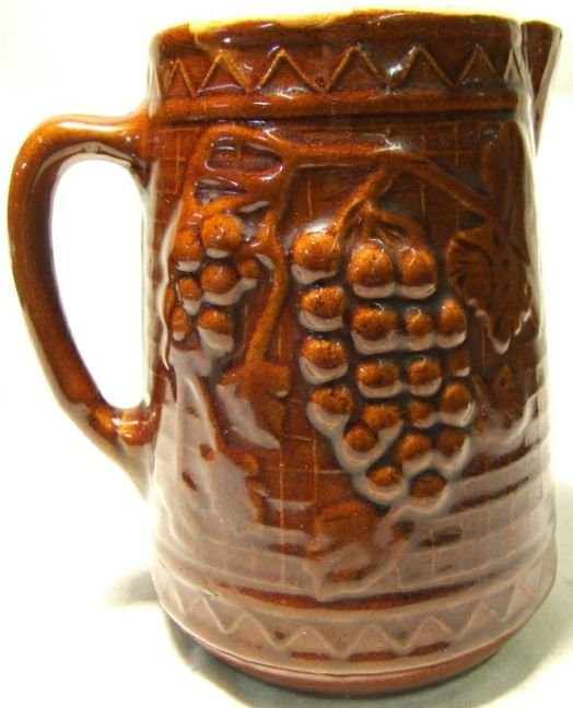 4004: Rockingham Brown Glazed Grape Design Pitcher, 8 H
