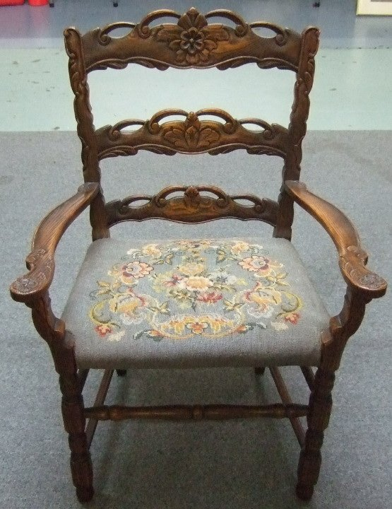 1008: Antique Carved Oak Arm Needlepoint Chair