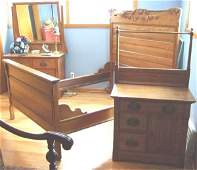 4101: Oak Three Piece Bedroom Set with Carved Crested H
