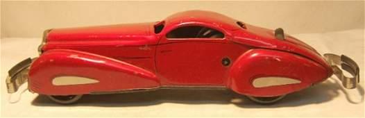 "1200: Marx reversing Coupe, 16"" Long, wind-up motor"