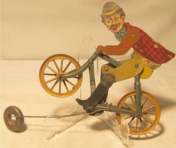 4011: Charlie Chaplin Tin Litho Bicycle Rider, US 1920'