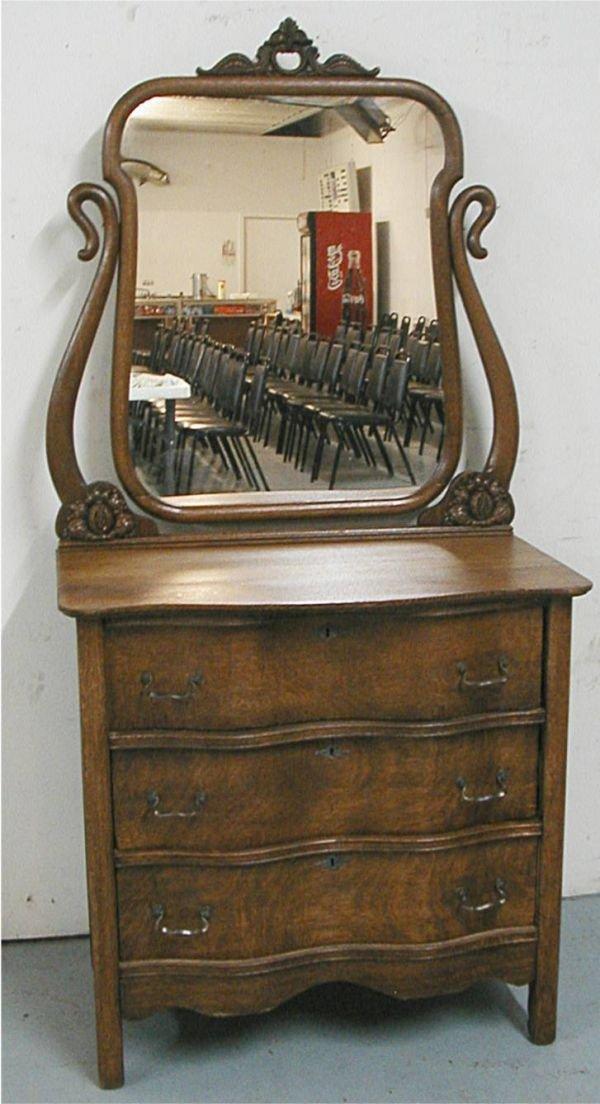 3010: Oak Three Dr. Serpentine Front Dresser