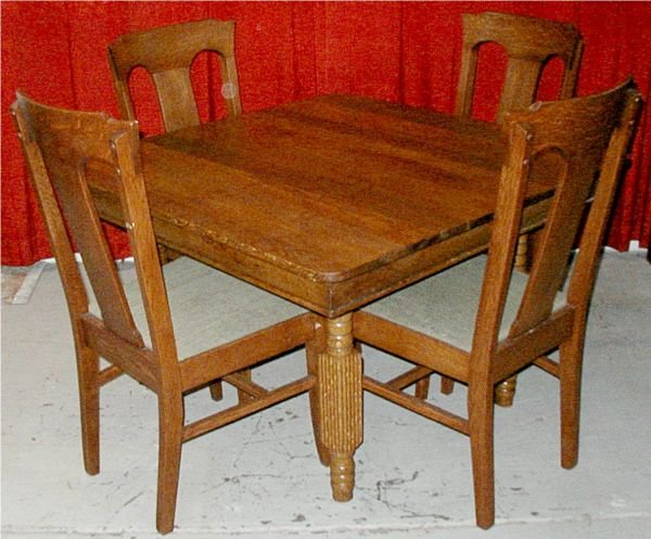 7: Oak Carved Farm Table with 4 Oak T Back Chairs