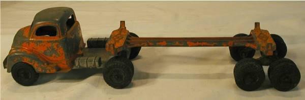 2012: Hubley Log Truck Orange in Color, 16 Inch Long