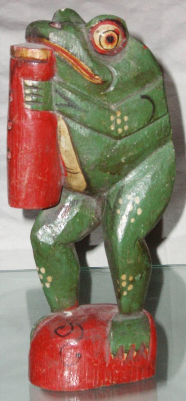 1021: Primitive Folk Art Carved Frog Playing Wind Instr