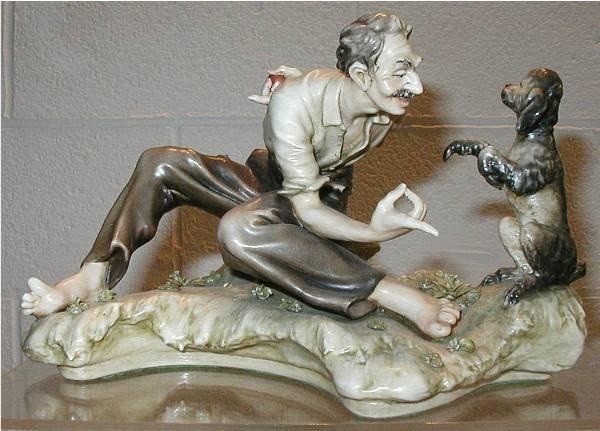 2083: Borsato Man Training Dog Figurine