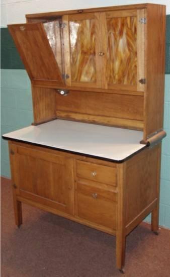 1002: Oak Hoosier Kitchen Cabinet with Two Slag Glass D