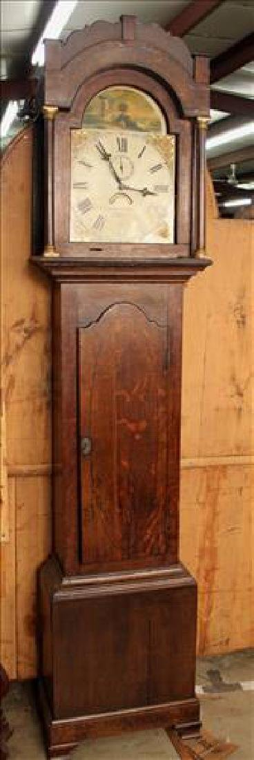 Oak grandfather clock with string inlaid door