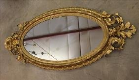Oval Victorian hanging mirror with gold gilded frame