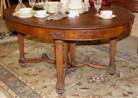 Solid mahogany oval dining table, 66 in. L, 29 in. W.