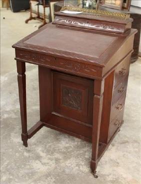 Mahogany Davenport desk with brass gallery