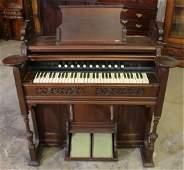 Walnut Victorian pump organ with stool