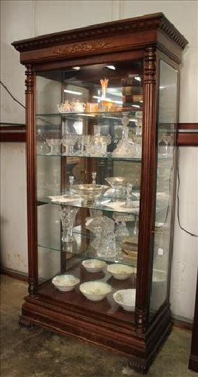 Mahogany lighted display cabinet with beveled glass