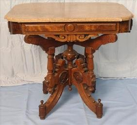 Walnut Victorian Eastlake table with marble top