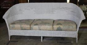 Antique white wicker sofa, 31 in. T, 73 in. W, 22 in.