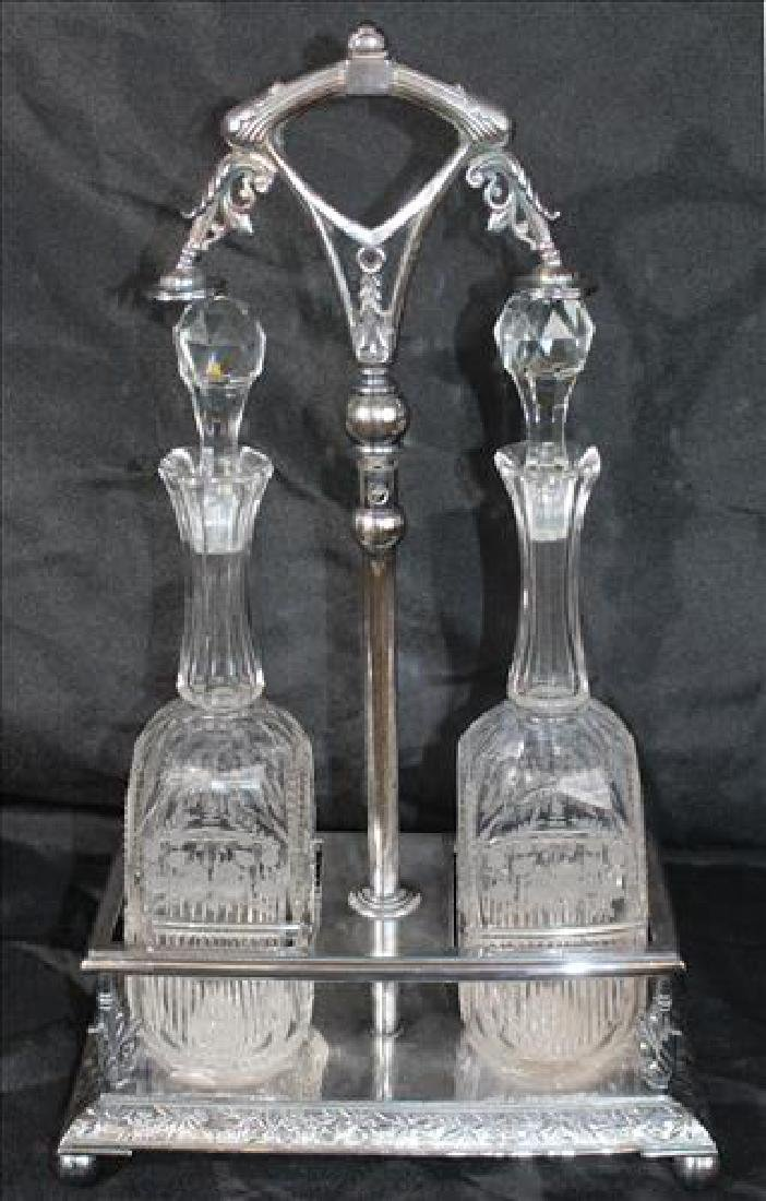 Cut glass Tantalus set with etched flowers