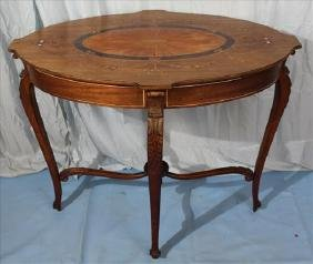 Mahogany oval inlaid banded top center table