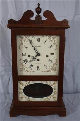 Mahogany mantle clock with West Minister chimes