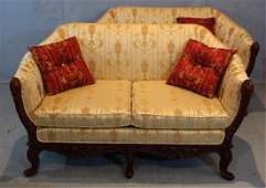 Pair rococo love seats with new gold upholstery