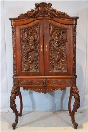 Walnut Victorian wine cabinet with cupids and ladies