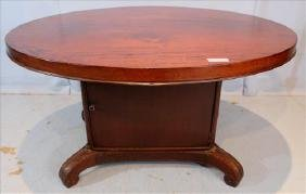 Mahogany oval center table with storage in base