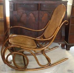 Antique bentwood rocker with lace cane