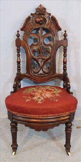 Walnut Victorian slipper chair with pierce carving