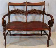 Solid mahogany 2 seater settee with horn of plenty