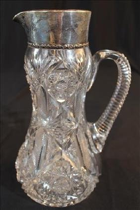 Brilliant cut glass water pitcher with sterling rim