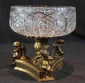 Cut glass center bowl with bronze base and cherubs