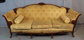 Walnut heavily carved French sofa with floral
