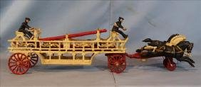 Cast iron toy fire engine with moving parts