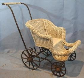Victorian wicker baby buggy with wood spoke wheels