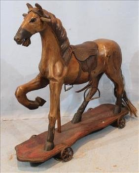 Wooden horse with real horse hair tail and saddle