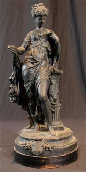 Metal statue of Greek woman sitting on column