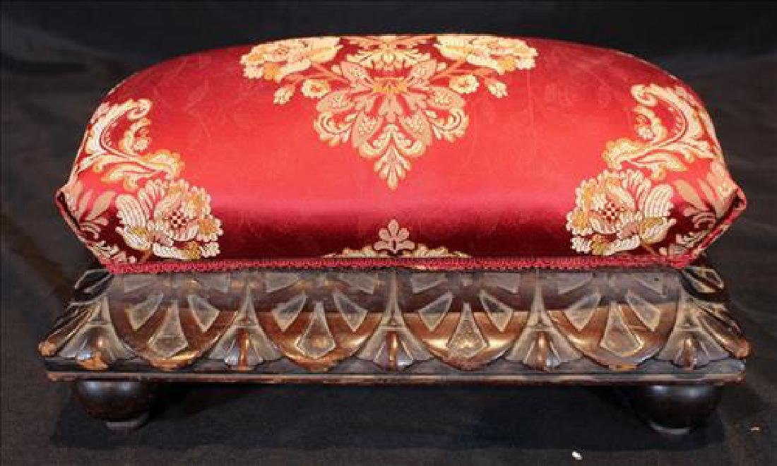 Small mahogany carved footstool with red upholstery