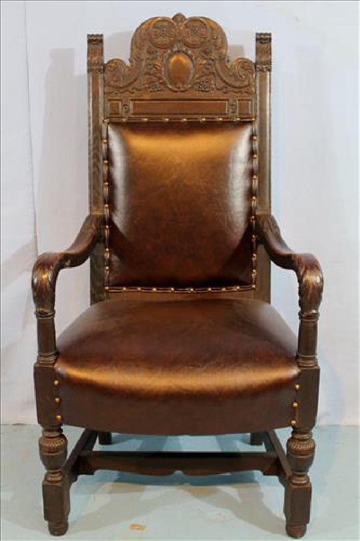 Heavy oak fireside chair with leather upholstery