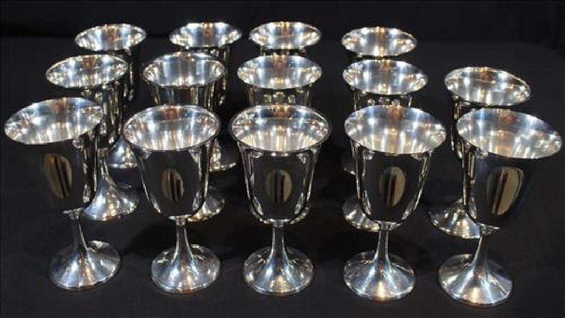 12 Sterling wine goblets, some by Wallace, 7 in. T.