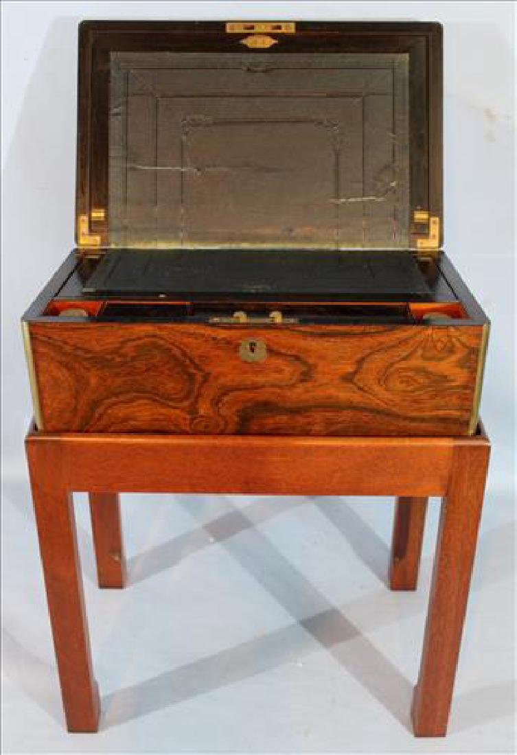 Rosewood lap desk on stand with original ink bottles
