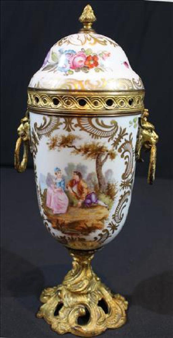 Hand painted Sevres porcelain caped urn, signed