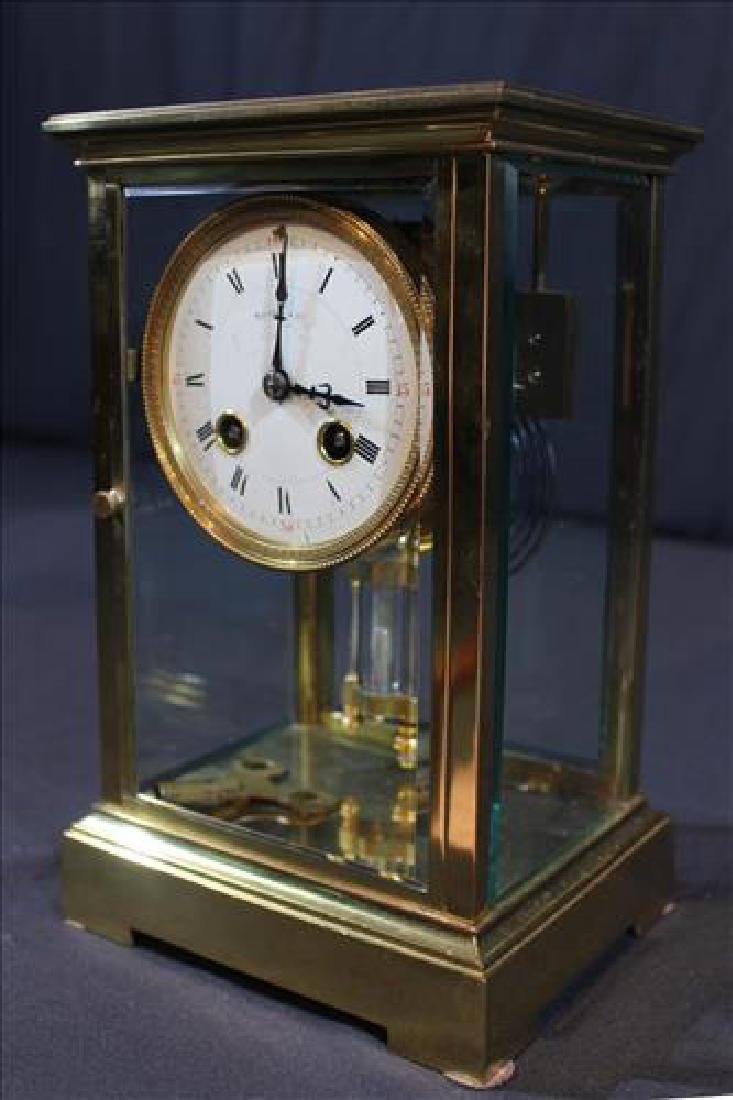 Brass and glass case clock signed Tiffany & Co.