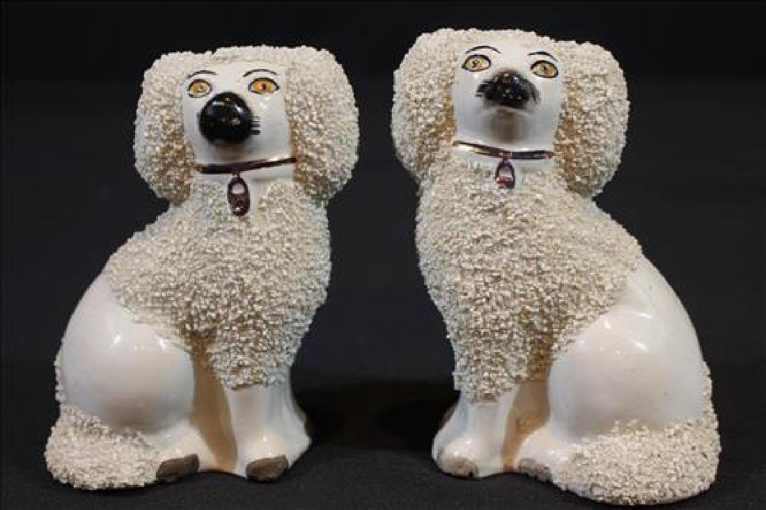 Pair small Staffordshire poodles,5 in. T, 4 in. W.